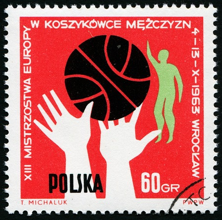 Post stamp printed in Poland showing  ball, hands and players, 13th European men basketball championship Wroclaw, circa 1963 photo
