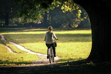 Young woman on bike photo