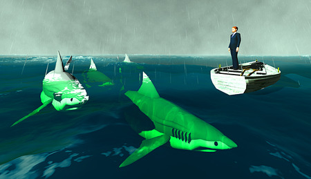 Determined businessman surrounded by sharks photo