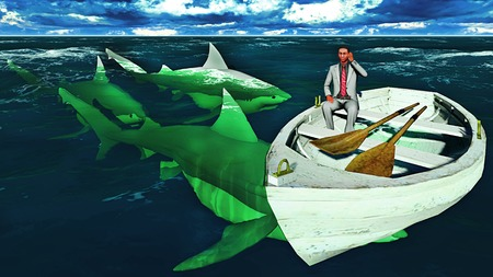 businessman surrounded by sharks calling for help on mobile phone photo