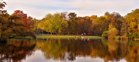 autumnal pond in park Stock Photo