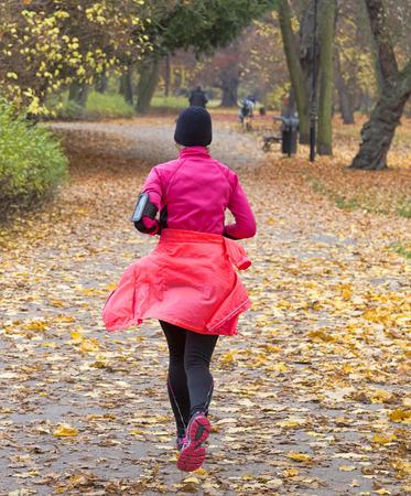 female jogger: Female jogger in   park Stock Photo