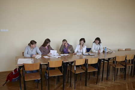 final examination: Wroclaw, Poland - March, 31, 2009: Polish female students  in a classroom at final examination Editorial