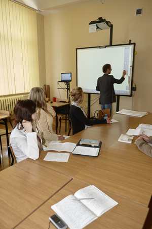 postgraduate: Wroclaw, Poland, May, 13, 2009-  female students in classroom before examination