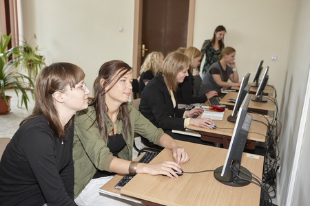 postgraduate: Wroclaw, Poland, May, 13, 2009-  female students in computer classroom