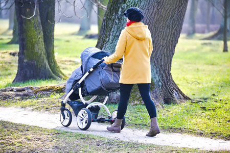 pram: Young mother with  pram