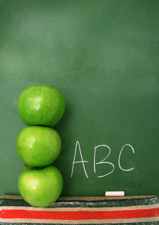Classroom chalkboard with apples.
