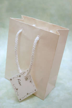 Gift bag with tag Stock Photo