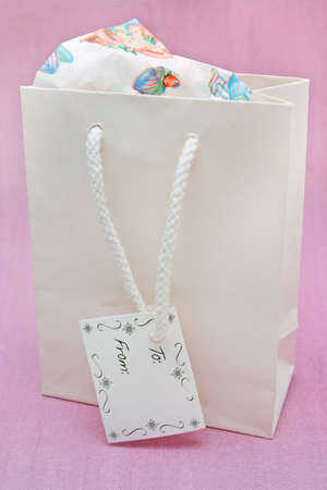 bagged: Gift bag with tag Stock Photo