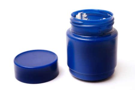 얼굴 표정:  Blue tub of facial cream 스톡 사진