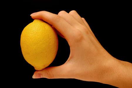 florida citrus:  Hand holding lemon