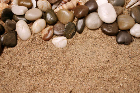 gritty: Smooth beach rocks and sand Stock Photo