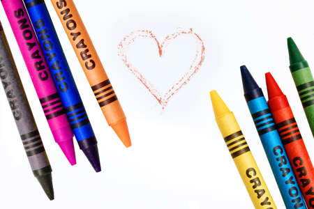 crayons with drawn heart