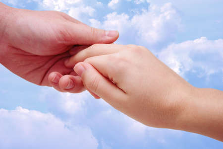 holding hands - clouds photo