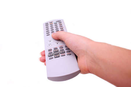 vcr: Hand holding television remote