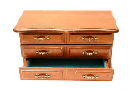 Miniature wooden dresser, bottom drawer open.