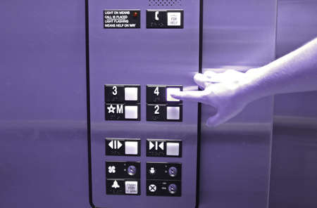 ascend:  Hand pressing elevator button