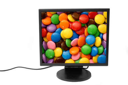 peripherals:  Flatscreen monitor isolated - chocolate candy background