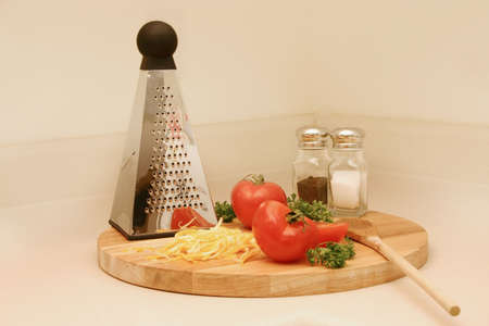 the grater:  Ingredients with grater. Stock Photo