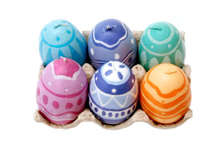 Easter egg-shaped candles with designs Stock Photo