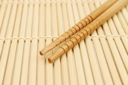 Bamboo mat and chopsticks   photo