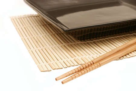 bamboo mat: Bamboo mat, dish and chopsticks