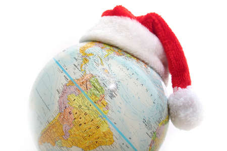 Santas hat on top of a globe. photo