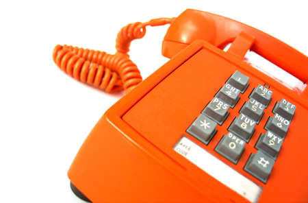 Old-school orange telephone, focus on buttons.