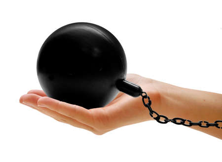 hand holding ball and chain Stock Photo