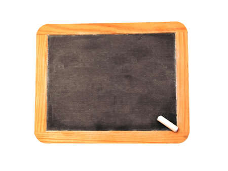 A blank chalkboard with a peice of chalk. photo