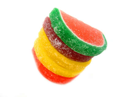 sugary:  A stack of sugary candy fruit, focus mainly on the top candies.