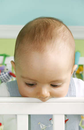 Baby Boy Playing in crib