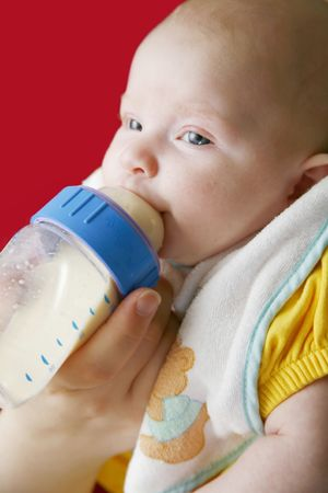 Baby girl feeding Stock Photo