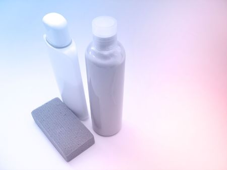 pastel shades: two bottles of cream and an emery board with pastel shades