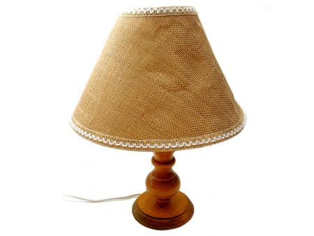 lamp shade: An old, used lamp on a white background.