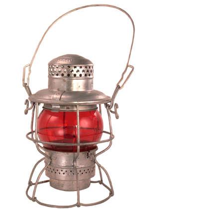 Antique kerosene powered railroad lantern with a red globe photo