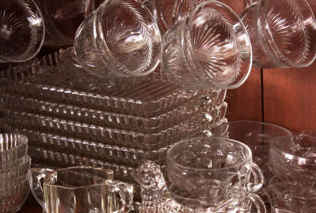 hutch: Collection of antique cut glassware in a hutch, with a glass chicken at bottom of frame.