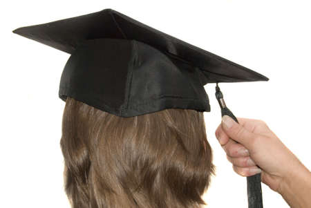 Graduate with tassel in hand on graduation day Stock Photo - 864540