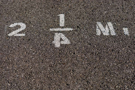 mileage: Mileage marker stenciled on pavement with reversed numeral four.