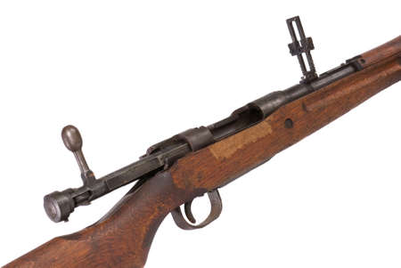 long range: Detail view of World War Two bolt action battle rifle, bolt open, long range sights up, white iso.
