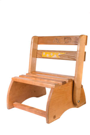 that: Wooden slatted childrens chair that converts into a two step stepstool, early 1980s vintage, white iso. Stock Photo