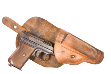 world war two: Small automatic pistol from World War Two partially withdrawn from its holster, white iso.