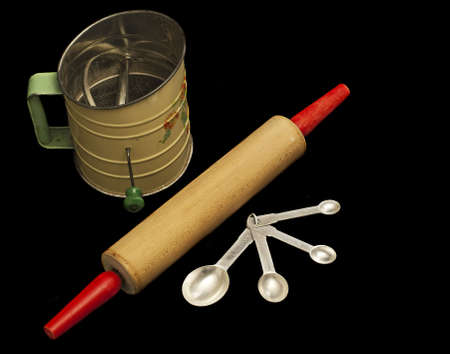 sifter: Vintage flour sifter, rolling pin, and measuring spoons, black iso.