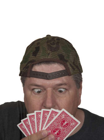 card player: Surprised card player looking at his hand.White isolation. Stock Photo
