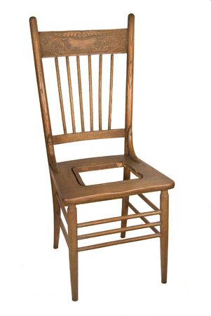 back kitchen: Antique oak carved back kitchen chair with rush missing from seat Stock Photo