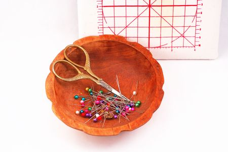 pinhead: Vintage sewing scissors, with sewing pins, in wooden bowl, miniature pinning board background.