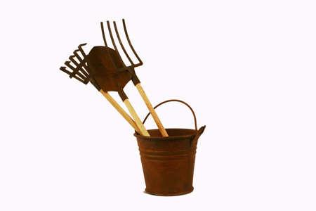 Rusty bucket and tools Stock Photo
