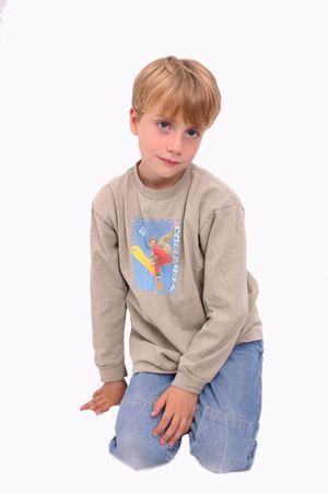 Boy kneeling, isolated Stock Photo