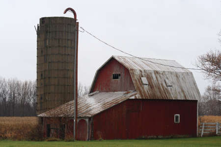 Old red barn with silo