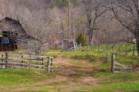 A nice view of an old barnyard with the old time wooden fence photo